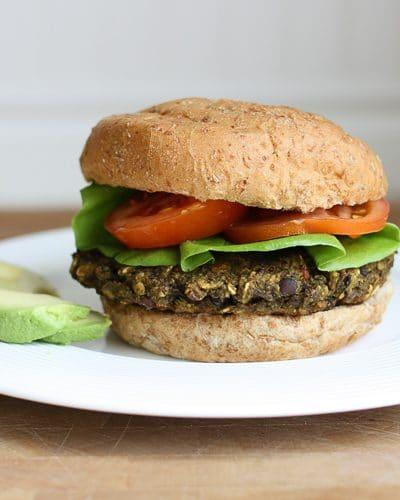 A veggie bean burger on a bun with salad