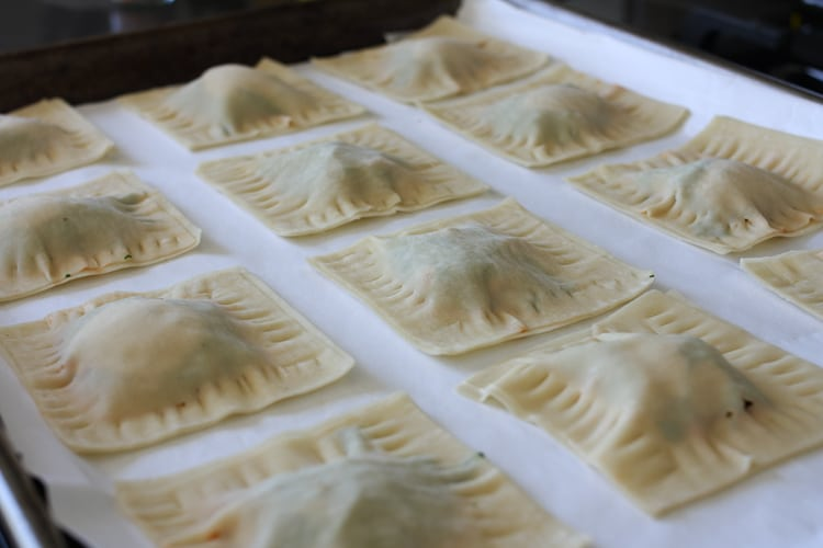 Lasagna wontons on a white surface ready to be cooked