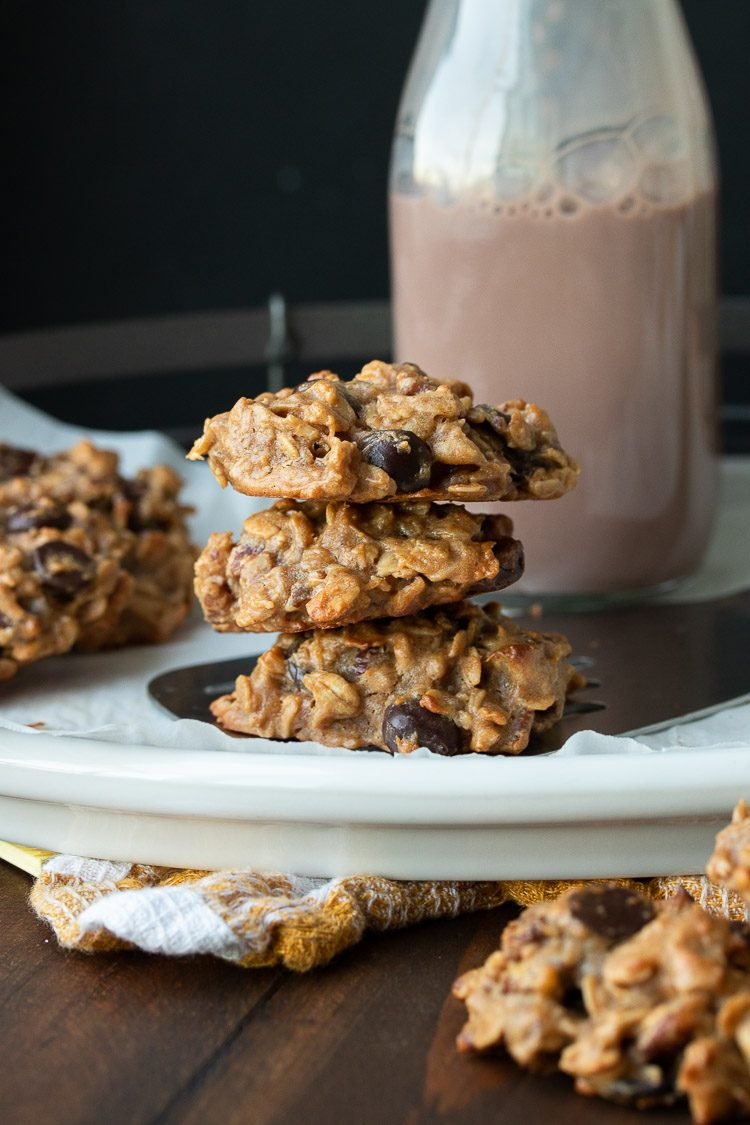 Stack of three oatmeal chocolate chip cookies on a plate