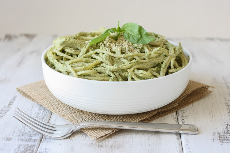 Lemon Hemp Seed Pesto and spaghetti in a white bowl