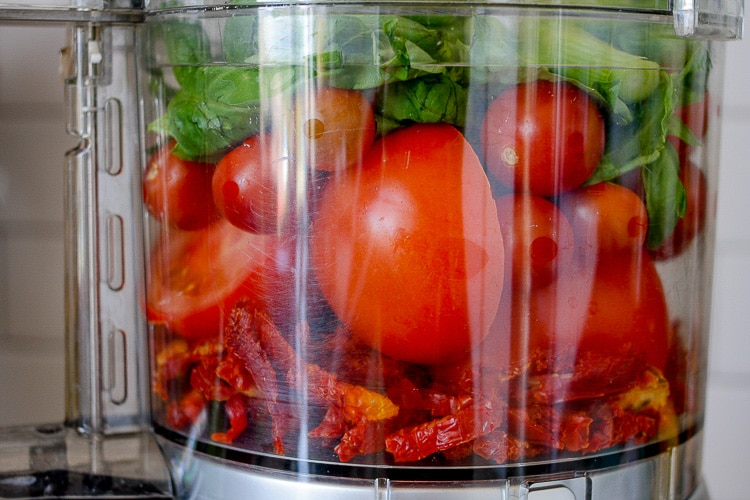 Ingredients to make a raw marinara sauce in a food processor