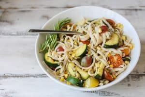 Linguine summer vegetables in a white bowl