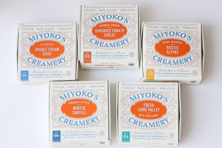 An overhead shot of 5 Miyoko's Creamery Vegan Cheeses in boxes