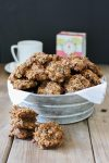 Vegan chocolate chip oat cookies in a bowl piled high