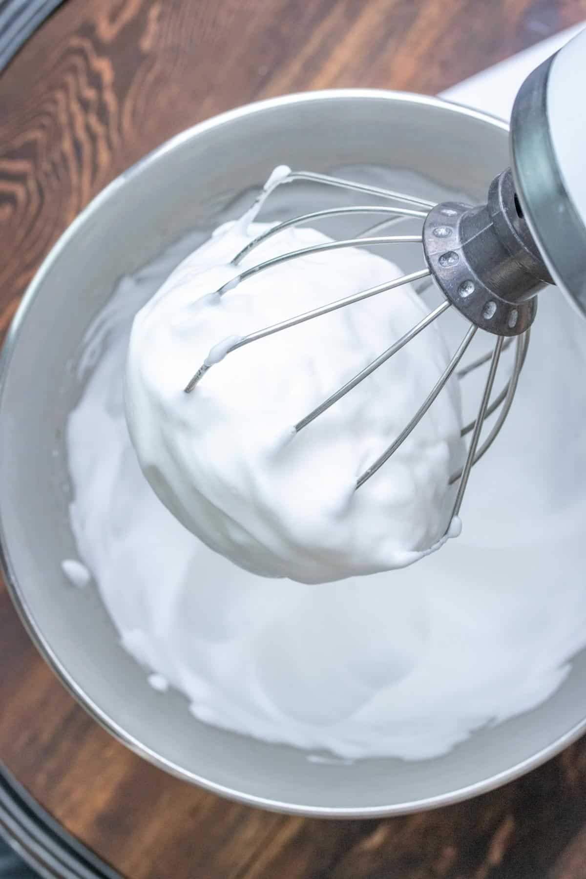 Stand mixer whipping up creamy frothy topping