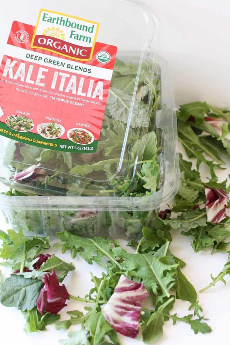 An open packet of earthbound farm saald green used to make stuffed Portobello Mushrooms