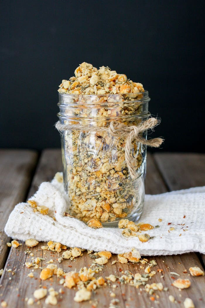 A photo of vegan sausage crumbles in a glass jar on a wooden surface