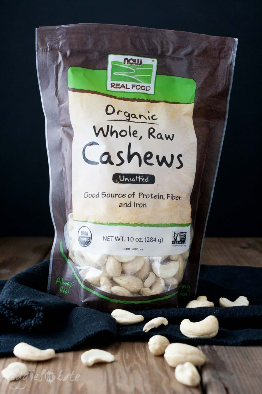 A bag of cashews on a wooden surface used to make a vegan Chocolate Mousse Dessert