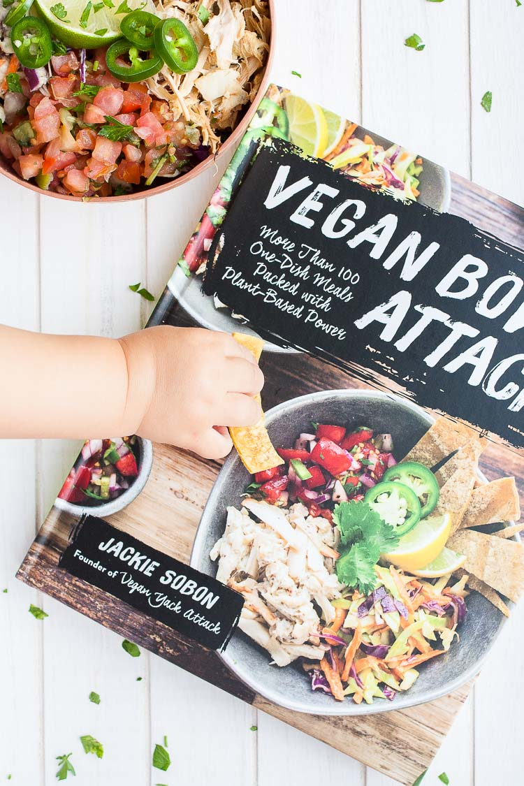 A close up of vegan bowl attack cookbook and a vegan fish taco bowl