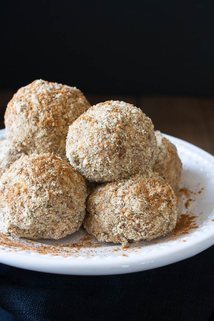 A close up of unfried ice cream balls on a white plate