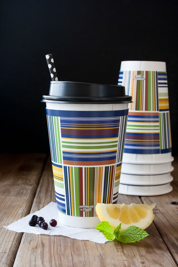 Colorful disposable coffee cup with a black lid