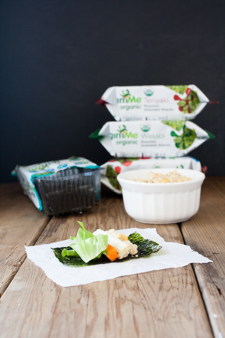 Easy Sushi Rolls Seaweed Snack Roll Ups sitting on a wooden surface