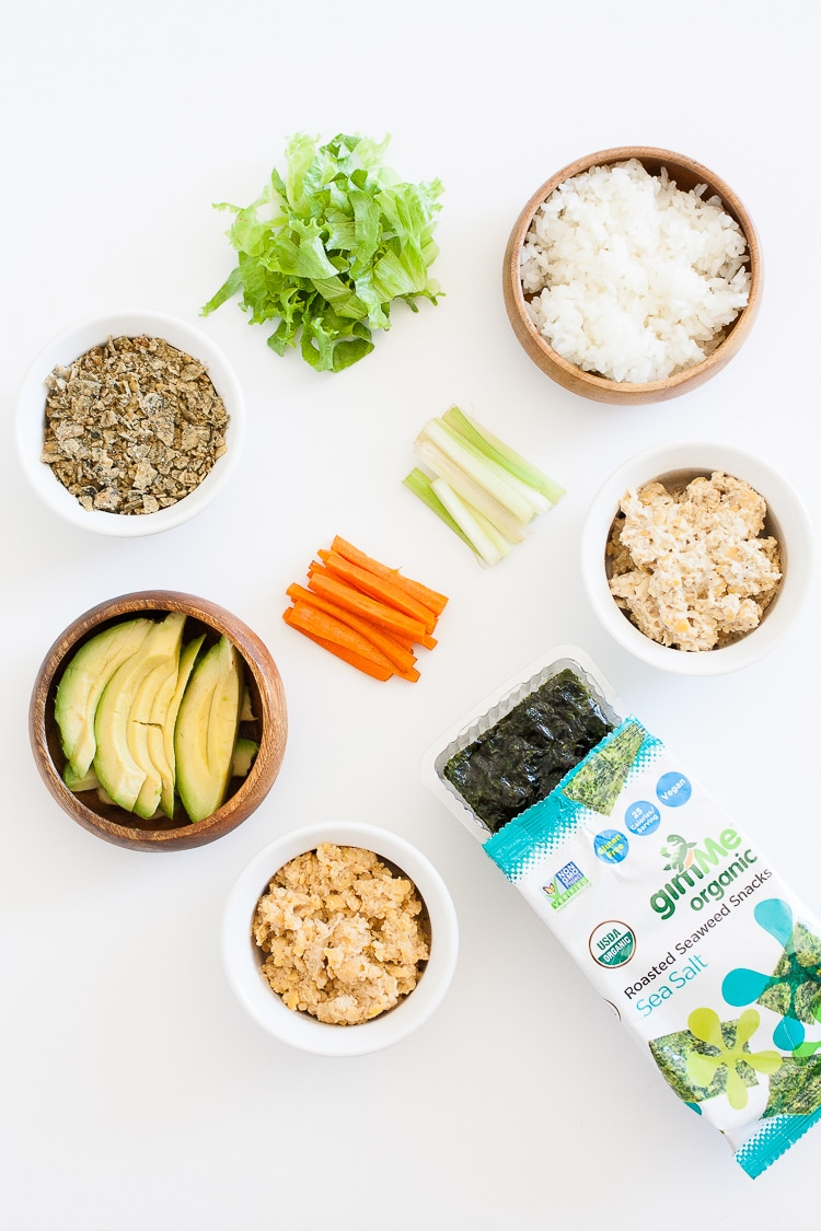 An overhead shot of ingredients to make seaweed sushi snacks for kids