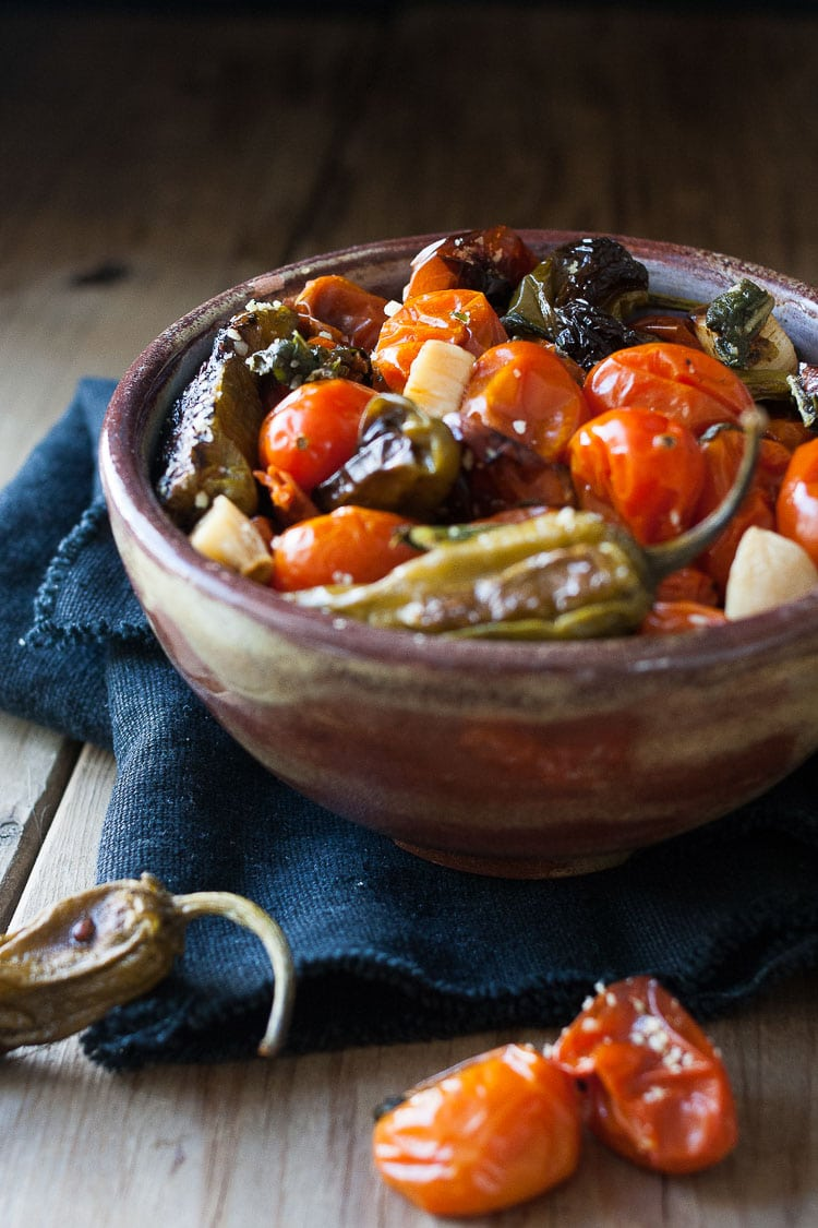 A photo of charred tomatoes and peppers in a bowl
