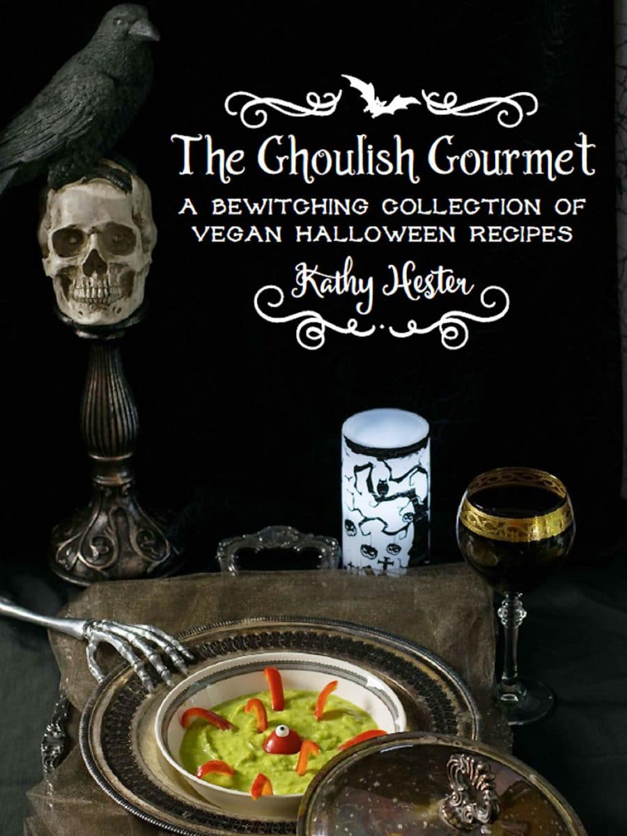 A book cover for vegan halloween recipes with a skull and bowl of green mush
