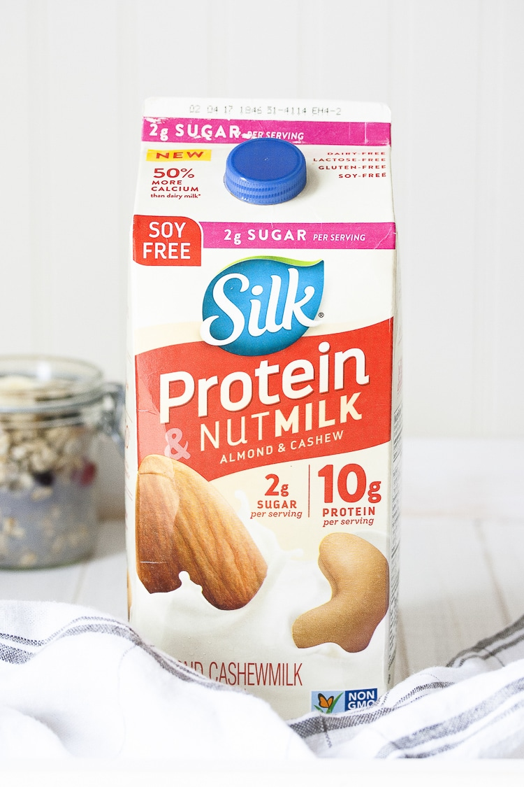 a carton of silk protein nut milk sitting on a white wooden surface