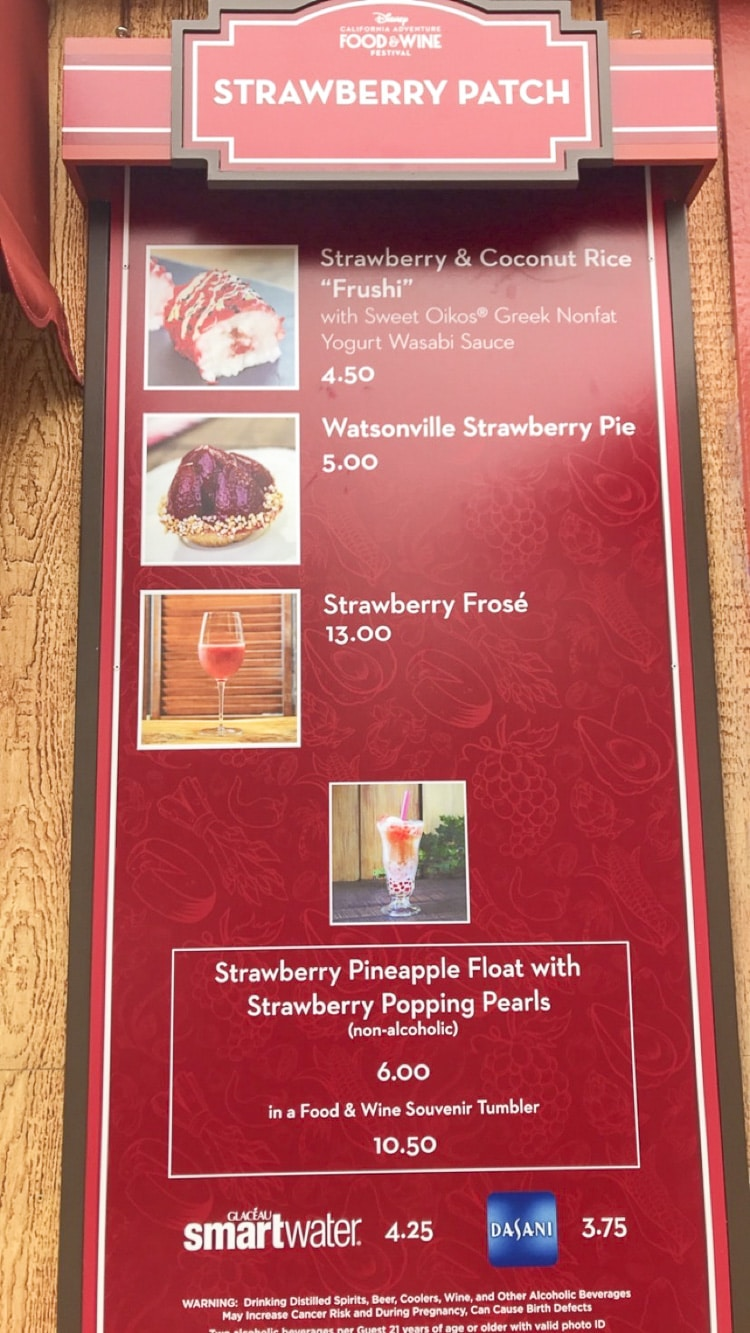 Red sign with list of strawberry based food options