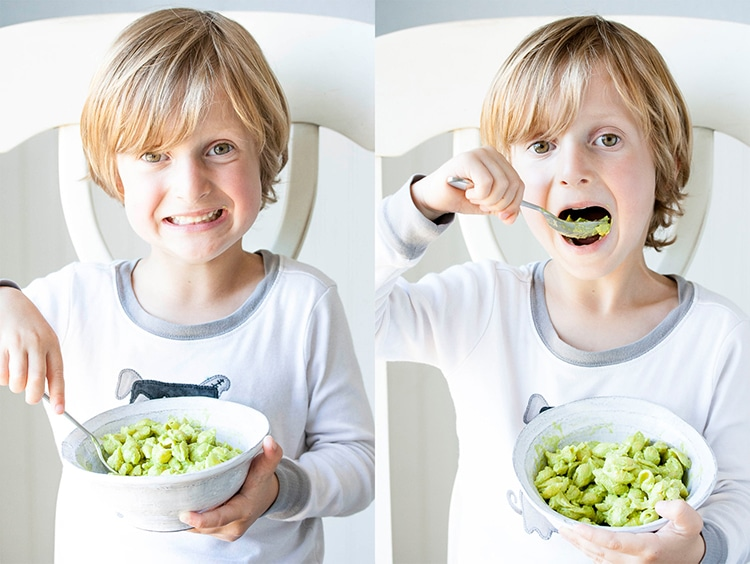 Collage of boy spooning bite of green mac and cheese then eating it.