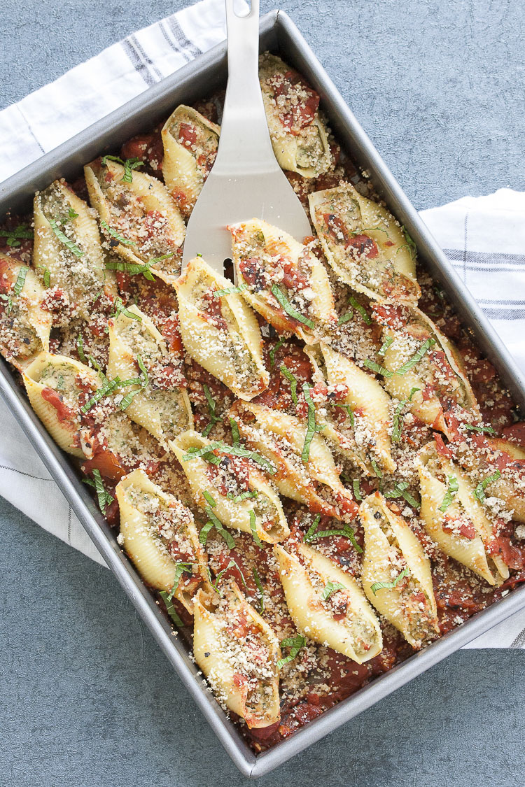 Pan of vegan stuffed shells with cauliflower ricotta