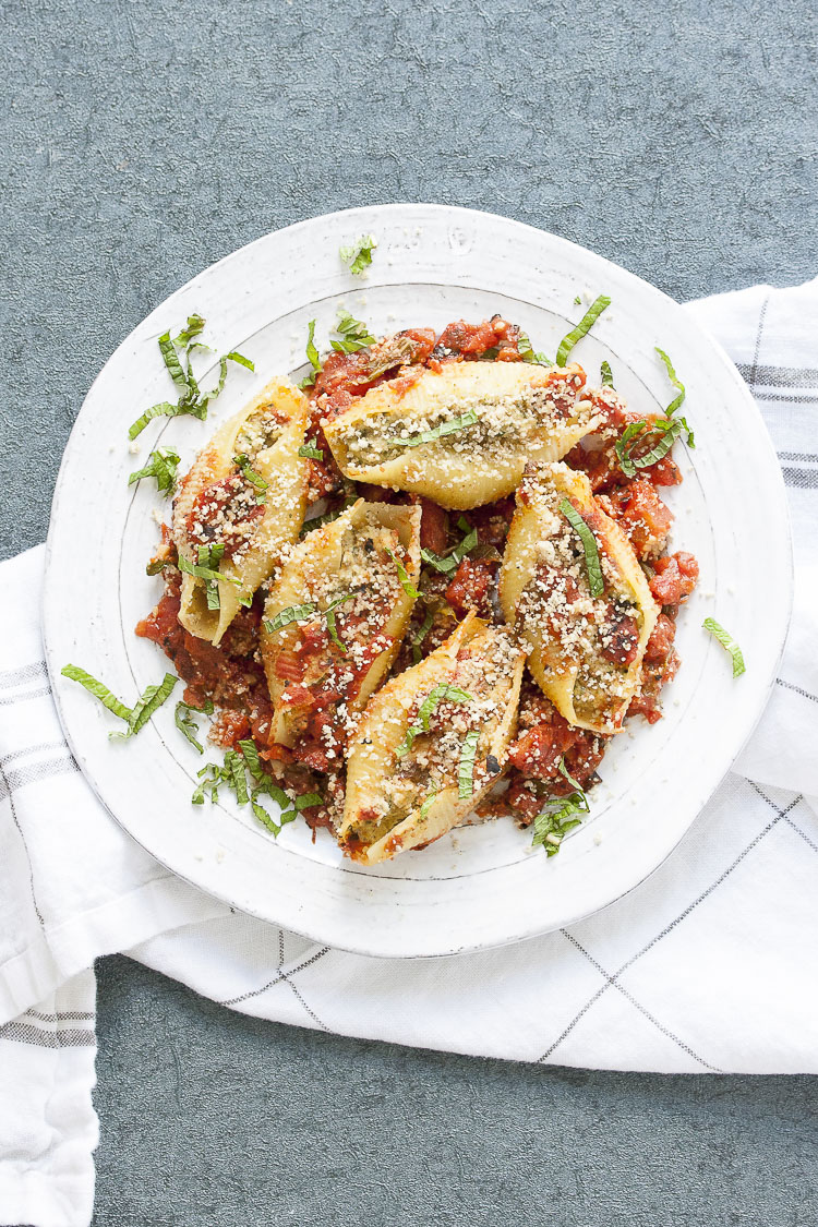 Vegan stuffed shells and cauliflower ricotta on a plate