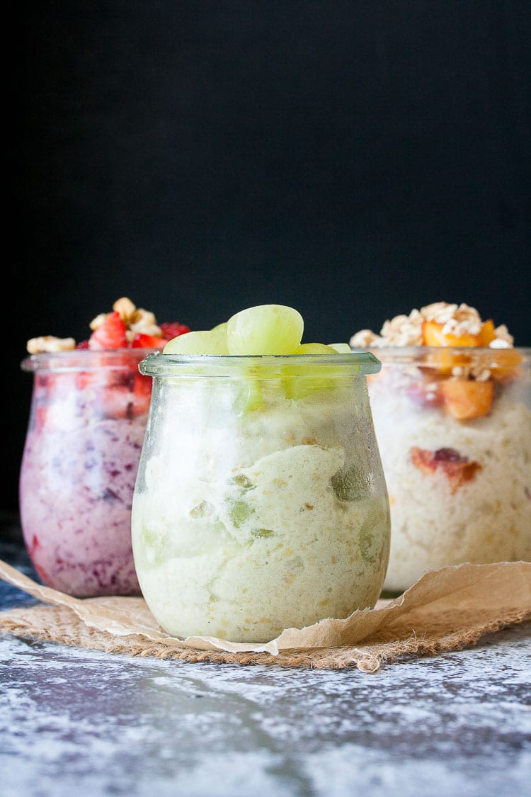 Three glass jars filled with instant frozen yogurt and toppings