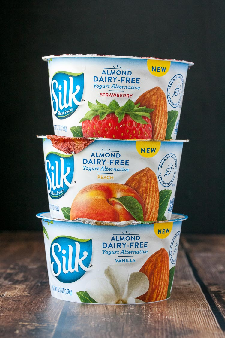 A photo of 3 Silk almond dairy-free yogurts stacked on top of each other