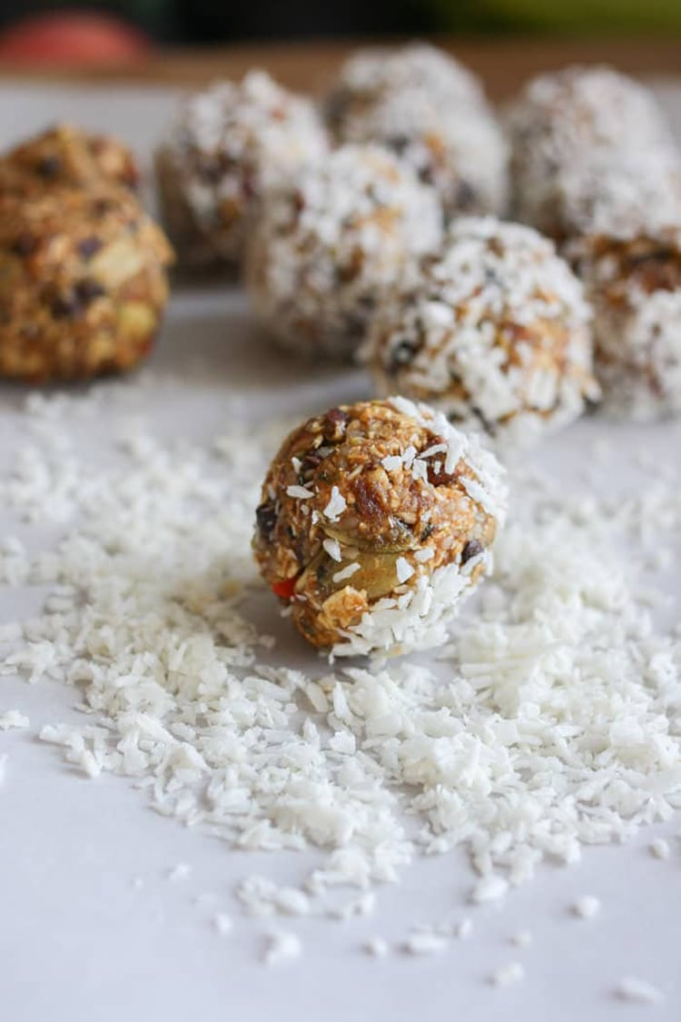 A close up shot of raw superfood balls rolled in desiccated coconut