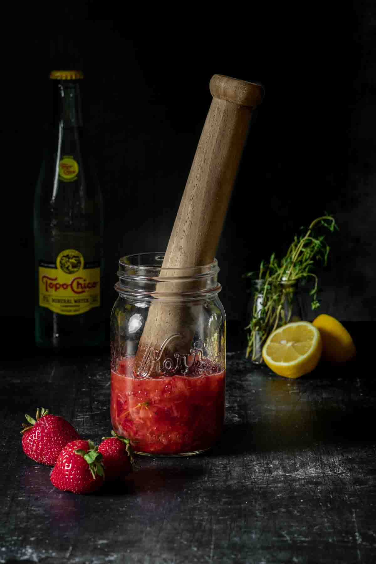 Muddle strawberries, thyme, lemon juice, vodka and sugar