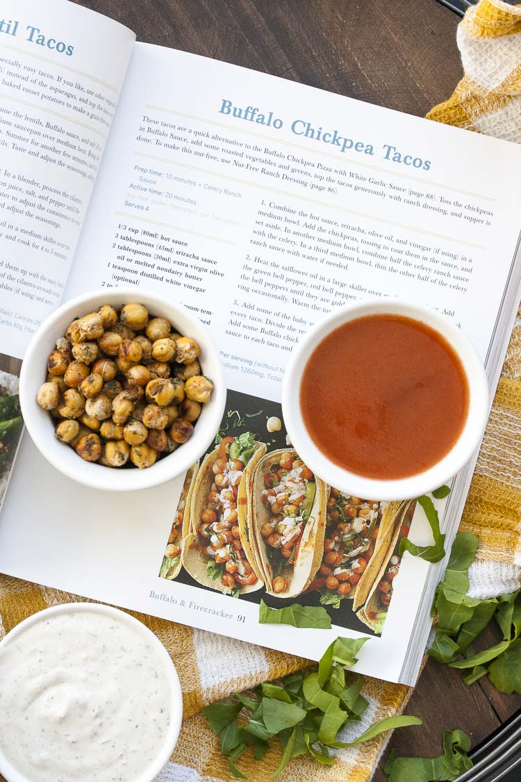 Top view of taco recipe from a cookbook next to recipe ingredients