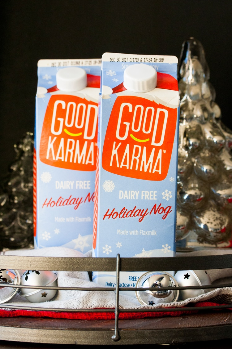 Two cartons of Good Karma holiday nog in a tray with Christmas decorations