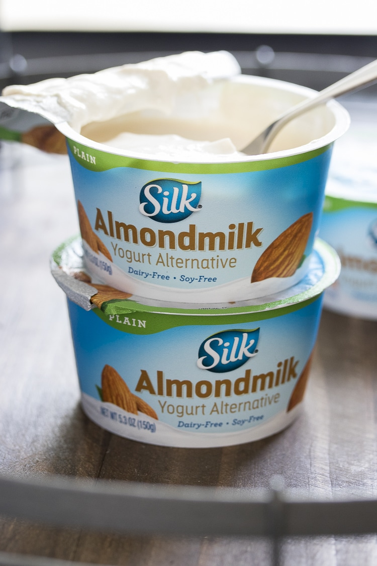 Two silk almond milk yogurt pots stacked on top of each other