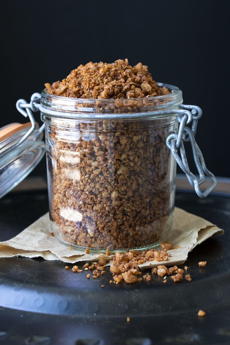 Glass jar with clamp lid filled with vegan taco meat crumbles
