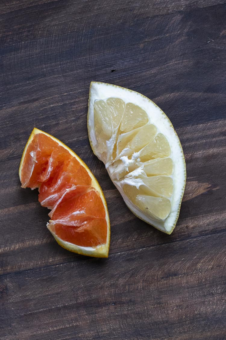 Slice of an orange and grapefruit inverted to show the pulp