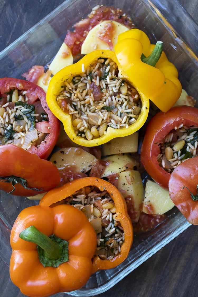 Peppers and tomatoes stuffed with rice mixture before being baked