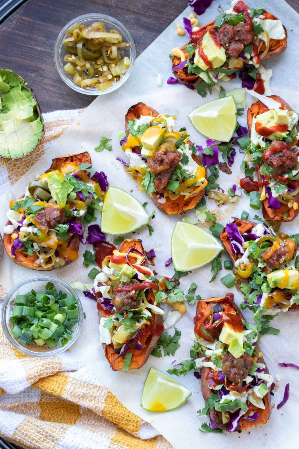 Top view of baked sweet potato skins fully loaded with toppings