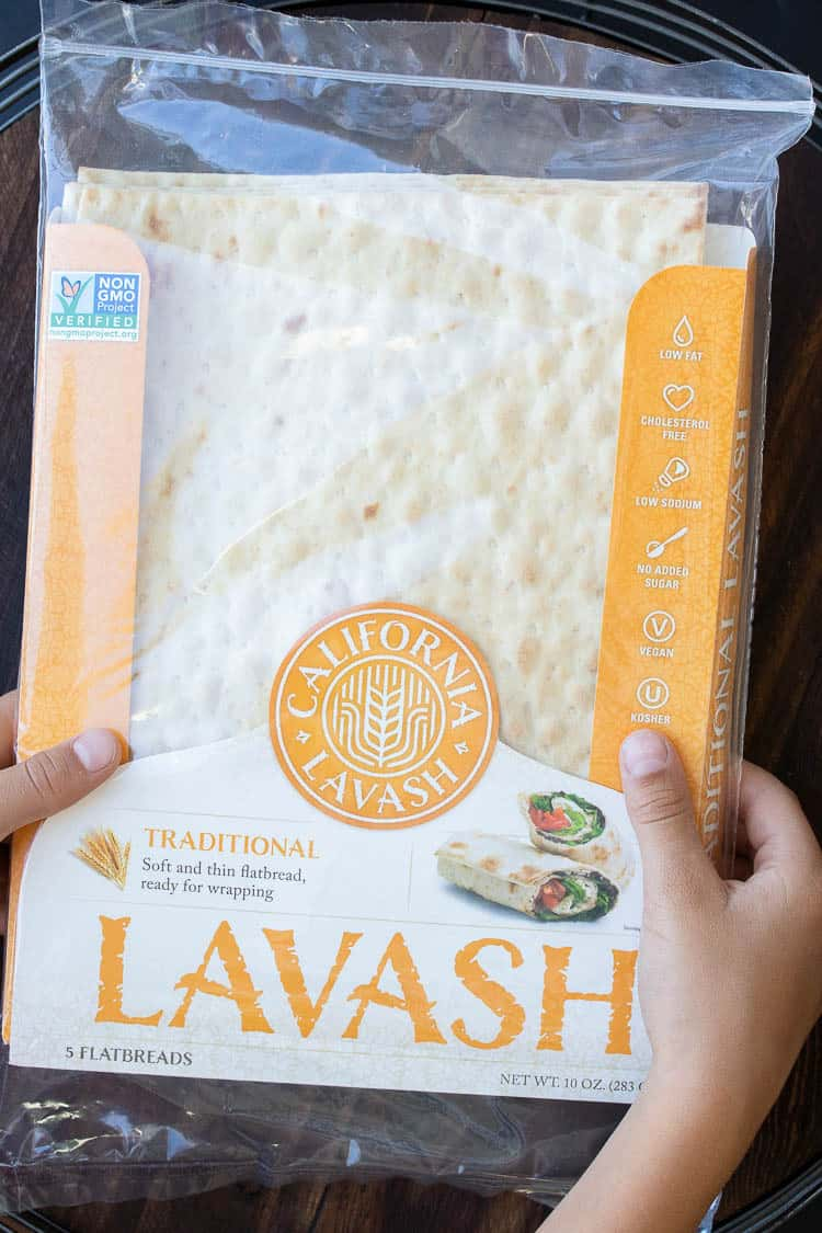 Hands holding a yellow package of lavash flatbread