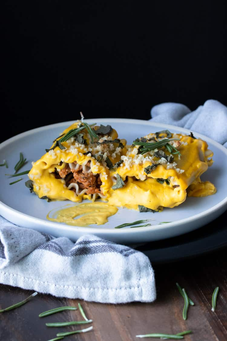 Front view of two sun dried tomato ricotta filled butternut squash lasagna roll ups