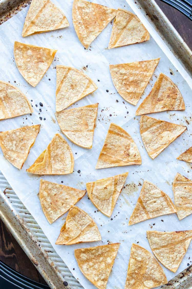 Bakes corn tortilla chips on a parchment lined cookie sheet