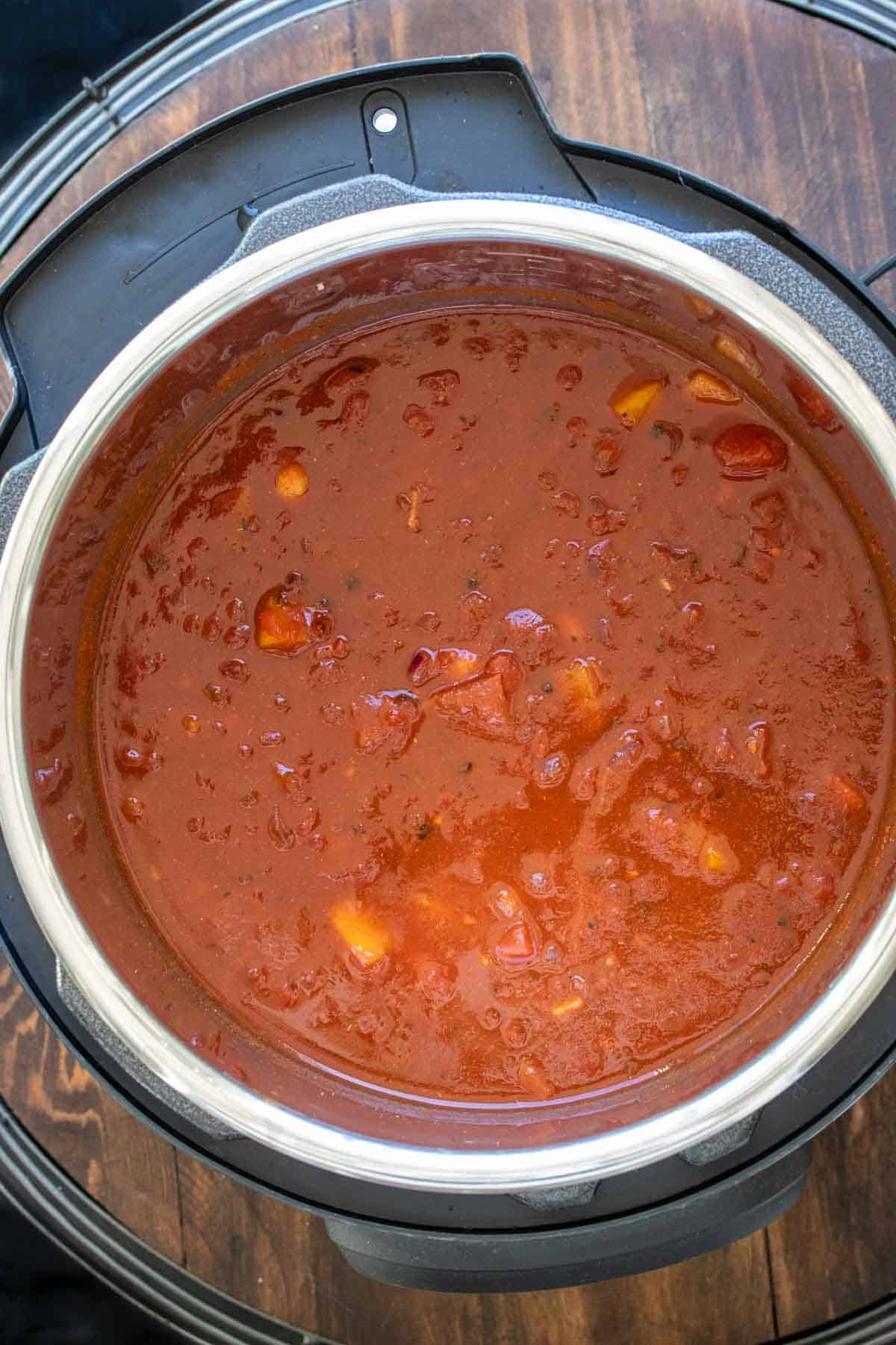 Slow cooker with bean chili ingredients inside
