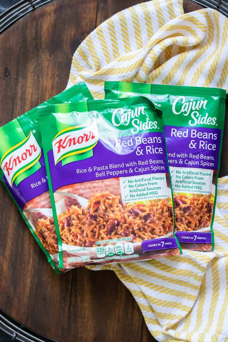 3 packs of Knorr Cajun red beans and rice on a wooden table