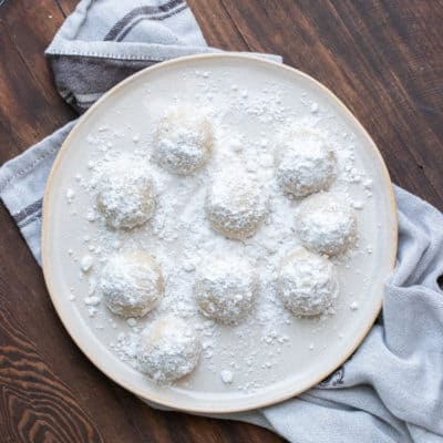 Cream plate with powdered sugar covered cookie balls