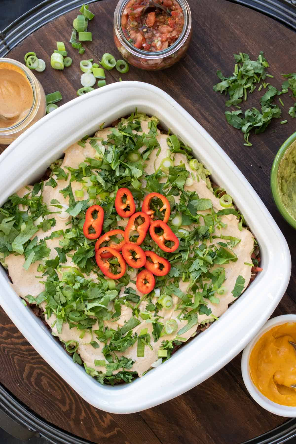 Top view of a 7 layer dip in a white baking dish