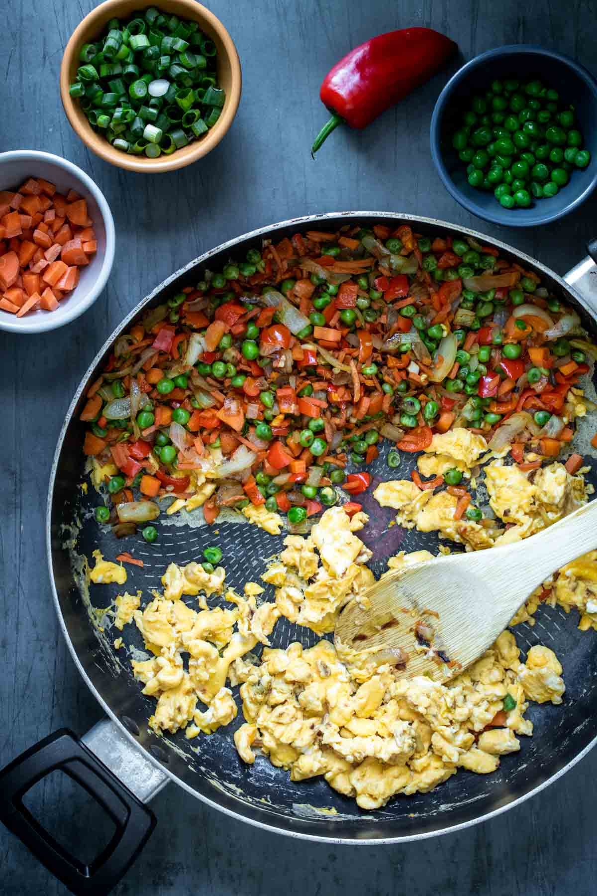 White bowl with handles filled with veggie fried rice