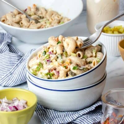 This vegan macaroni salad is a perfect remake of the classic deli style variety. It's mayo free but creamy, flavorful and made with whole foods! #healthydinnerrecipes #veganpicnicfood