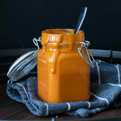 Spicy, classic vegan buffalo sauce that goes with everything. This recipe is made without butter for a delicious whole foods option for those that want it! #vegansauces #wholefoodsrecipes