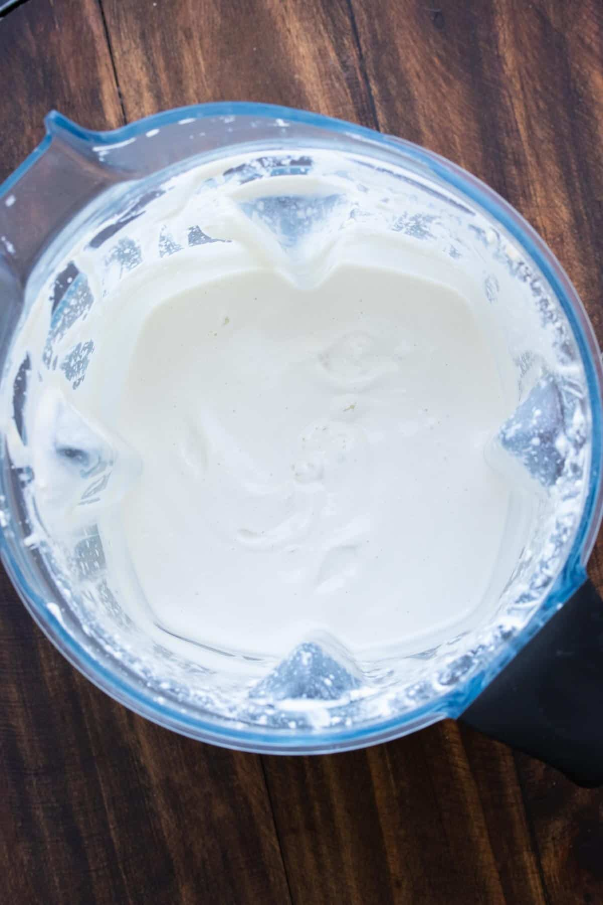 Top view of blender with homemade yogurt inside
