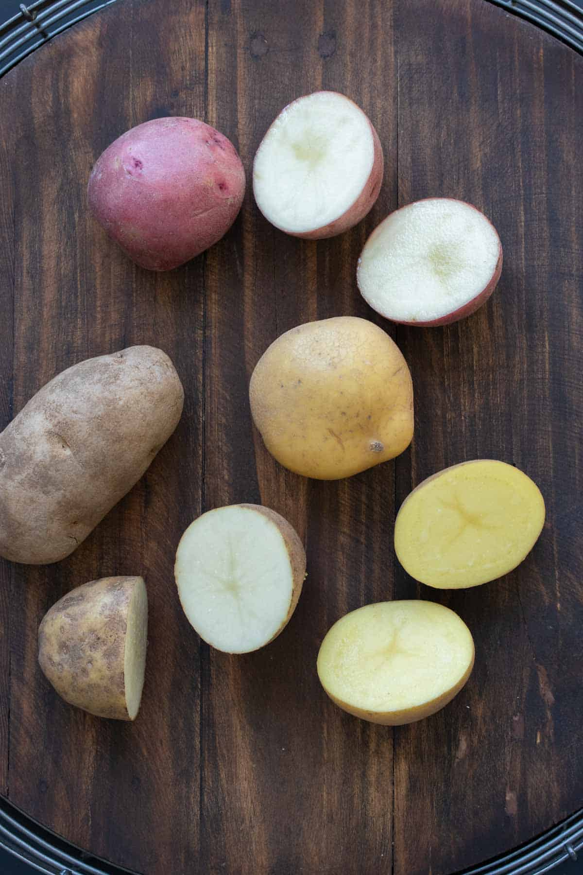 Different kinds of potatoes cut in half on a table