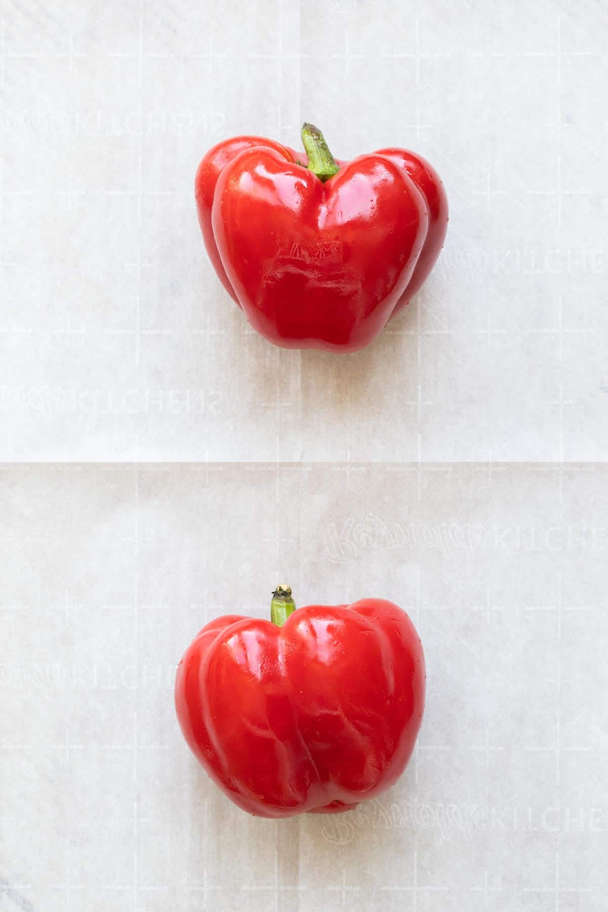 Two red peppers on a sheet of parhcment