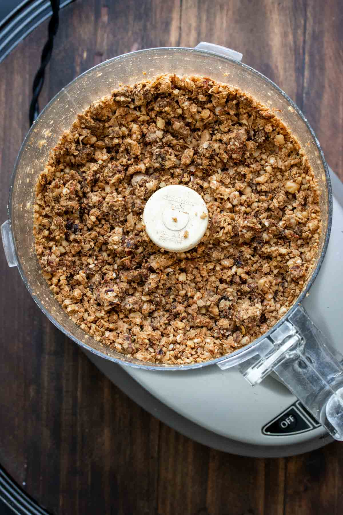 Top view of a food processor with vegan chorizo crumbles in it