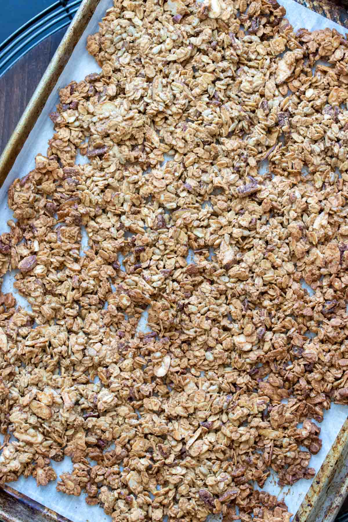 Pan of baked granola spread over it